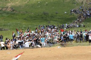 Palestinian refugees marching to Palestine via the Syrian border. May, 2011
